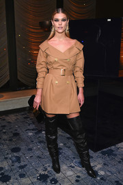 Nina Agdal attended the Stuart Weitzman presentation looking stylish in a short tan trenchcoat by Alice + Olivia.