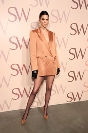 Kendall Jenner paired her jacket with nude pumps by Stuart Weitzman.