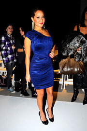 Miss Bailon showed off her svelte figure in a sapphire blue rusched mini dress and a sophisticated pair of black patent leather pumps. The platform shoes gave her tiny frame a boost and the shiny finish complemented her bold evening look.