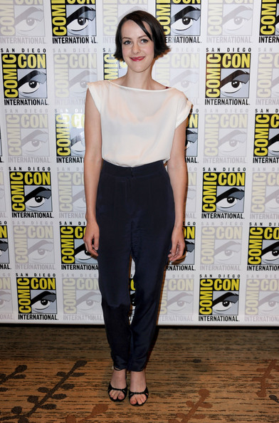 Jena Malone paired her top with blue silk trousers.