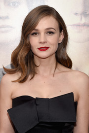 Carey Mulligan added a splash of color with a swipe of bold red lipstick.