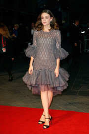 Carey Mulligan went for simple styling with a pair of black satin ankle-strap sandals.