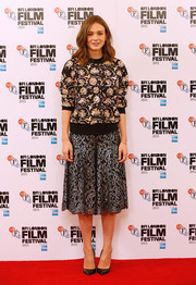 Carey Mulligan kept it relaxed yet chic in a black and gold floral sweater by Chanel at the 'Suffragette' photocall.