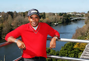 Sugar Ray Leonard paired his red v-neck sweater with a blue baseball cap.