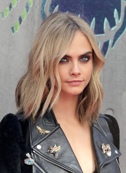 Cara Delevingne finished off her look with her signature smoky eyes.