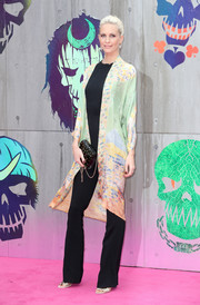 Poppy Delevingne prettied up her jumpsuit with a colorful kimono.