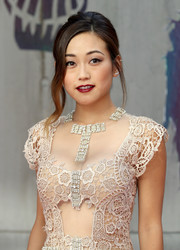 Karen Fukuhara glammed it up with this loose updo with wavy tendrils at the European premiere of 'Suicide Squad.'