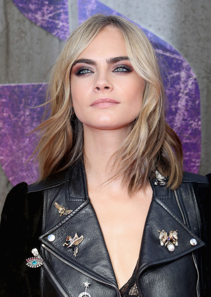 More Pics of Cara Delevingne Medium Wavy Cut (1 of 24) - Cara Delevingne Lookbook - StyleBistro [hair,blond,face,hairstyle,eyebrow,beauty,lady,long hair,layered hair,fashion,red carpet arrivals,cara delevingne,european,england,london,odeon leicester square,suicide squad,premiere,european premiere]