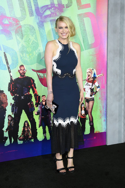 Leven Rambin paired her frock with elegant black satin sandals.