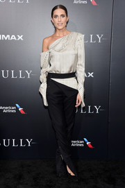 Allison Williams looked fashion-forward in an asymmetrical striped blouse by Monse at the New York premiere of 'Sully.'
