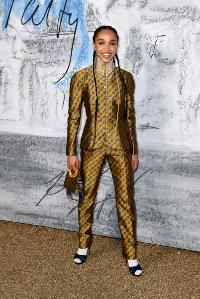 FKA Twigs styled her suit with navy cross-strap sandals and white socks.