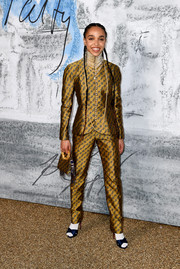 FKA Twigs opted for a vintage gold Dior pantsuit when she attended the 2019 Serpentine Gallery Summer Party.