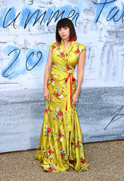 Charli XCX gave us Oriental vibes with this chartreuse floral wrap gown by Vivienne Westwood at the 2019 Serpentine Gallery Summer Party.