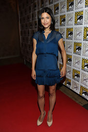 Julia Jones opted for a ladylike look at Comic-Con in bone leather pumps and a sheer teal shirtdress.