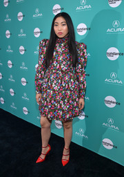 Awkwafina teamed her frock with strappy red pumps by Malone Souliers.