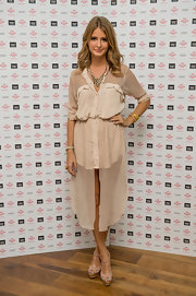 Millie Mackintosh matched her flowy shirtdress with a pair of patent platforms.