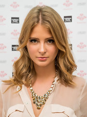 Millie Mackintosh wore her wavy hair down during the Sunday Strut fashion for a cause event held in London.
