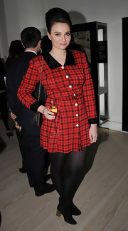 Gizzie topped off her plaid style with black tights and black ankle boots.