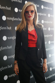 Georgia May Jagger donned a cute pair of pink-rimmed round sunnies during the Sunglass Hut cocktail party.