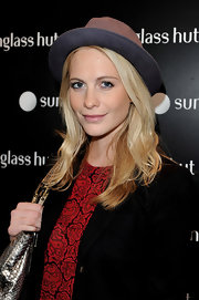 Poppy Delevigne showed off her spunky style while hitting the Sunglass Hut store opening in London, England.