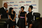Fantasia Barrino was spotted backstage at the Super Bowl Gospel 2013 show wearing a cute LBD with a pink bow belt.