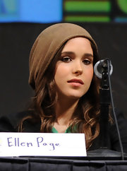 Ellen showed off a tan beanie while doing a press conference.