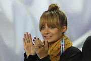 Nicole Richie looked adorable sans makeup and with her hair in a simple top knot while attending a rugby match.