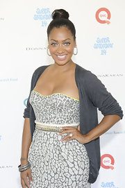 La La Anthony attended the Super Saturday event wearing a gray cardigan over a strapless print dress.