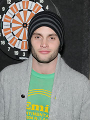 Penn Badgley looked decidedly casual in a black and gray striped beanie at the Superdry Lounge Party.