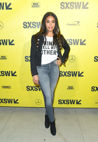 Regina Hall layered a black military jacket with gold buttons over a printed white shirt for the 2018 SXSW premiere of 'Support the Girls.'