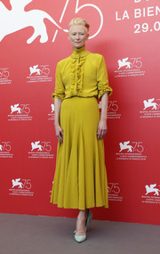 Tilda Swinton's pastel-blue pumps made a lovely contrast to her citrine dress.
