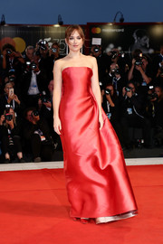 Dakota Johnson was a classic beauty in a strapless red gown by Dior Couture at the Venice Film Festival screening of 'Suspiria.'