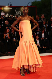 Alek Wek donned a strapless peach Calvin Klein By Appointment gown for the Venice Film Festival screening of 'Suspiria.'