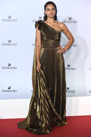 Shanina Shaik was a golden goddess in this pleated one-shoulder gown at the Swarovski Crystal Wonderland party.