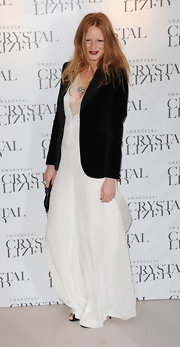 Olivia Inge wore a white lacy gown with a sharp blazer to the model search event in London.