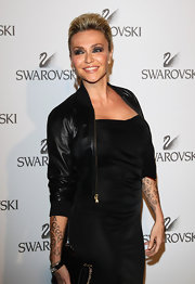 Paola Barale layered a cropped black leather jacket over her dress for a rocker-chic feel.