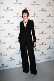 At the Swarovski Fashionation in Milan, Erin O'Connor paired her black wrap top with matching black wide leg trousers.