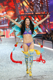 Embroidered thigh-high boots sealed off Adriana Lima's vibrant ensemble.