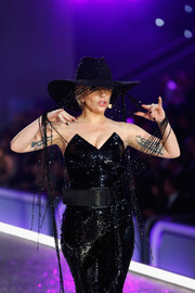 Lady Gaga styled her sparkly outfit with an oversized black belt.
