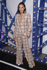 Selita Ebanks looked cool in a grid-print pantsuit by Monse at the Swarovski Times Square celebration.