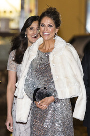 Princess Madeleine arrived for the World Childhood Foundation's 20th anniversary wearing a white fur jacket over a silver sequined dress.