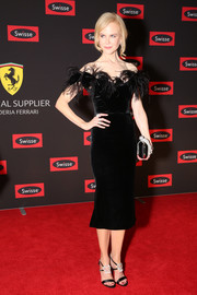 Nicole Kidman got all jazzed up in a black Marchesa velvet dress, featuring a fitted, off-the-shoulder silhouette and a feathered neckline, for the Swisse Wellness 'Power Your Passion' event.