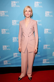 Cate Blanchett teamed her graceful rose suit with pointy metallic pumps.