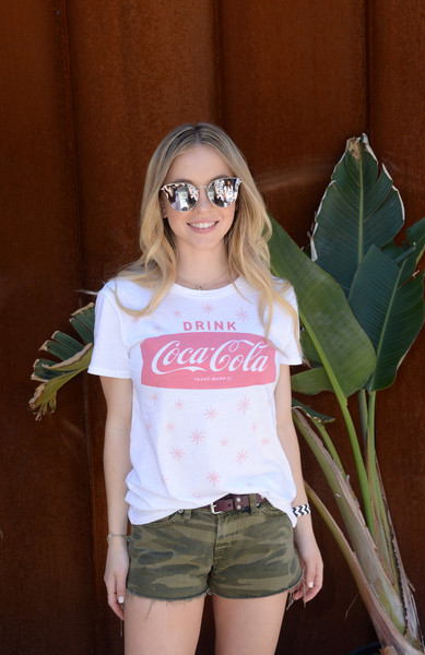 Sydney Sweeney Cateye Sunglasses [white,clothing,t-shirt,glasses,shorts,blond,shoulder,eyewear,cool,smile,sydney sweeney,rolling stone live present desert jam,palm springs,california,arrive hotel,lucky brand]