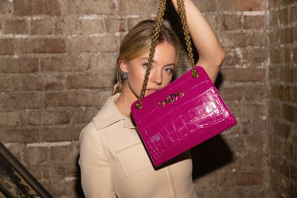 Sydney Sweeney Chain Strap Bag [nordstrom host private event to celebrate the opening of new handbag shop,shoulder,pink,beauty,joint,bag,magenta,blond,fashion accessory,fashion,material property,sydney sweeney,downtown seattle,washington,barboza,gucci]