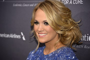 Carrie Underwood sported a drop-dead gorgeous messy updo at the T.J. Martell Foundation gala.