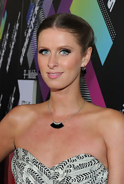 Nicky Hilton jazzed up her bare neckline with a black gemstone necklace at the T-mobile launch event.