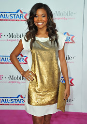 Gabrielle redefined sporty spice at the NBA All-Star Game in a sequined T-shirt dress accessorized with a sleek gold envelope clutch.