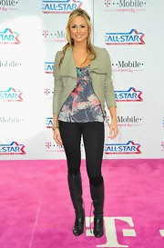 Stacey Keibler donned black perforated knee high boots with tonal cap toes to the NBA All-Star game.