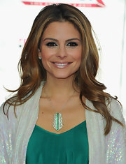 Maria paired her teal blouse with a matching teal and diamond pendant necklace.